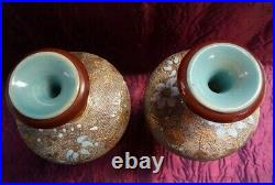 A pair of Doulton lambeth/Slaters vases