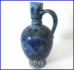 Early Doulton Lambeth stonware jug by Emily J Edwards 1874